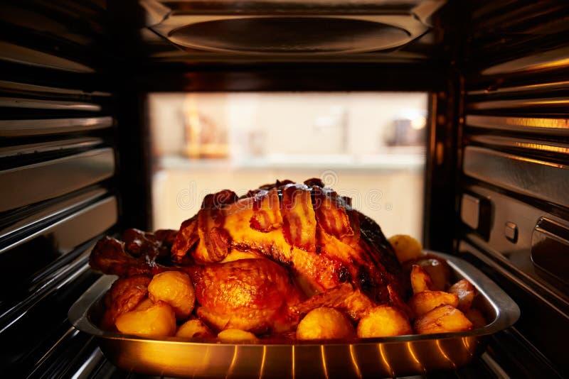Thanksgiving Turkey Roasting Inside Oven royalty free stock image