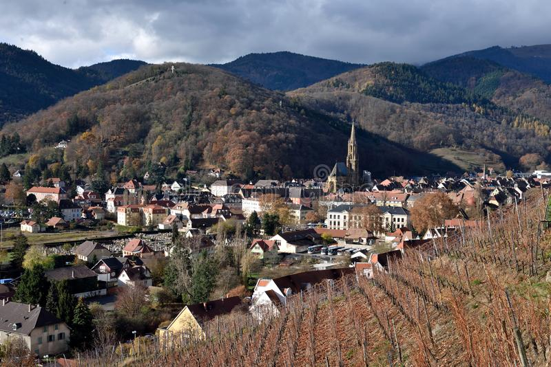 Thann. View from vineyard. Thann is the town situated at the foot of the Vosges mountains, at the mouth of the valley of the Thur River. France royalty free stock photos