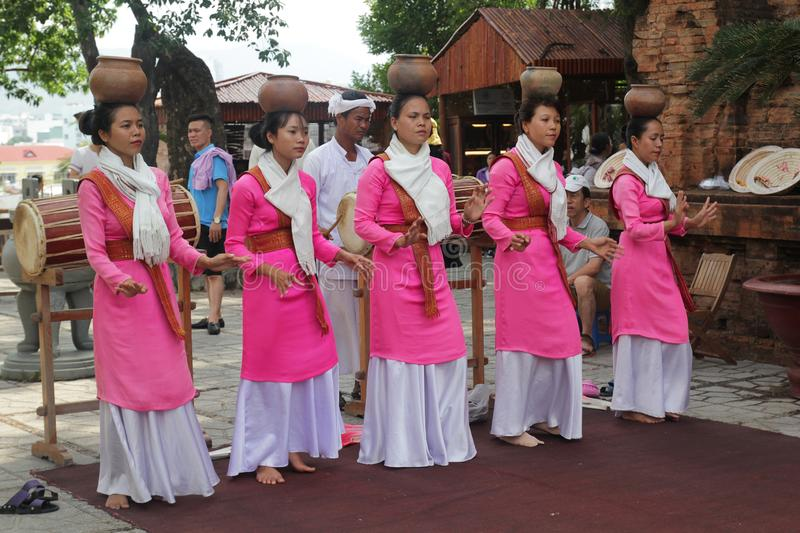 Thap Ba Ponagar, Nha Trang, Viet Nam - May 22,2018: Women in pink long dress is dancing Champa dance of Champa people at Thap Ba p. This is a traditional dance stock photography