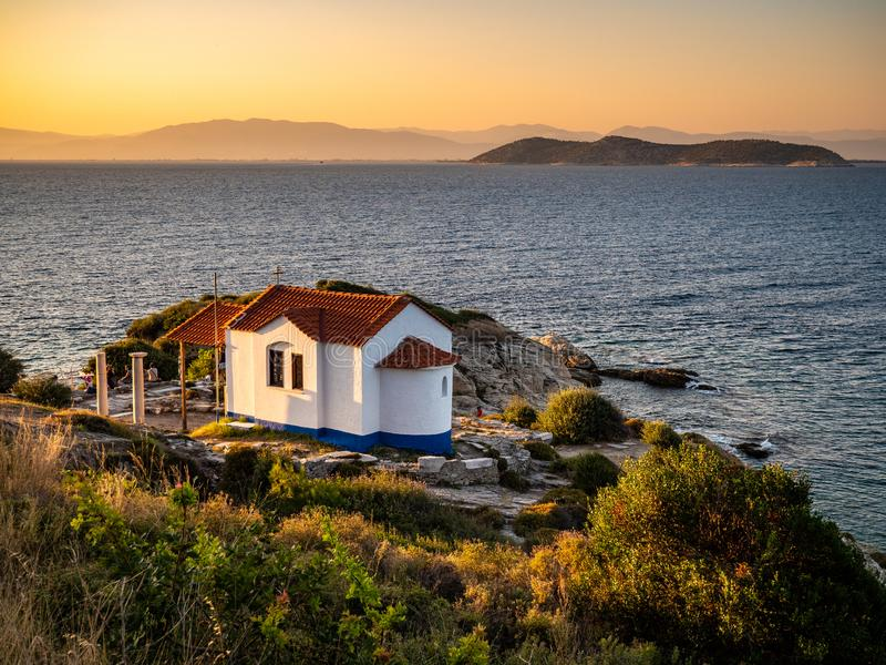 Thasos, Greece, beautiful view at sunset overlooking the sea with a small church visible in the front. Thasos or Thassos Island is a summer destination island stock images