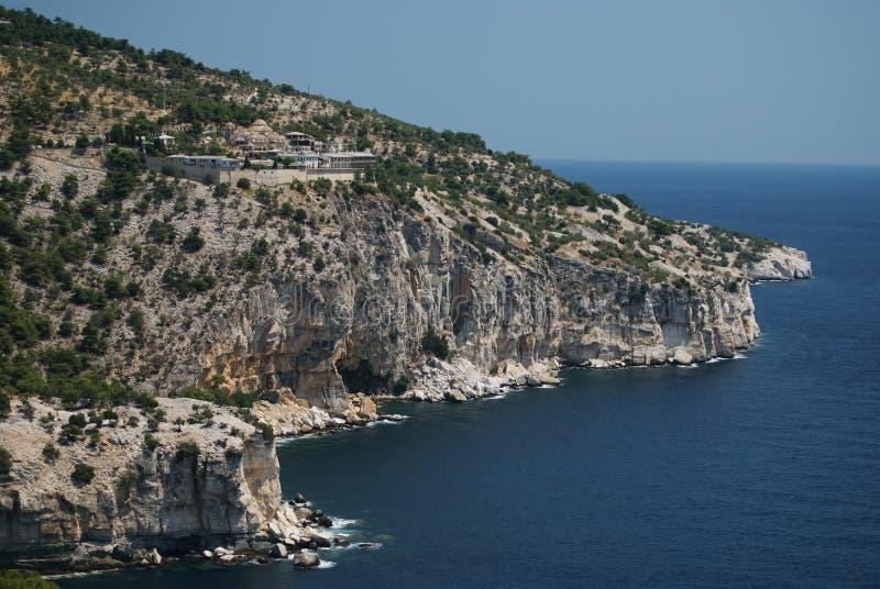 Thassos. Coast of Aegean island Thassos, Greece with Archangel Michael's Monastery stock image