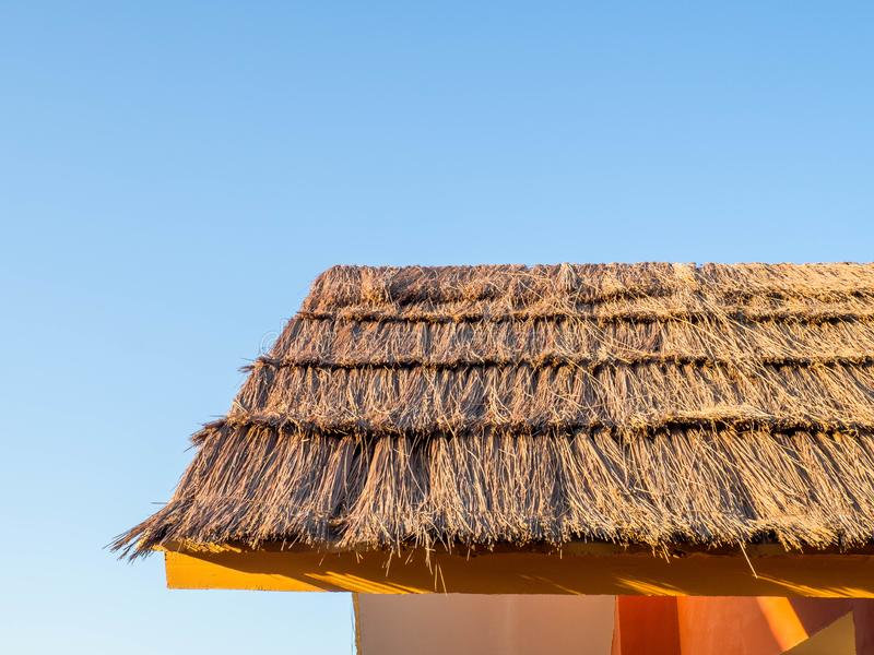 Thatch roof background, hay or dry grass background. Thatch roof texture stock images