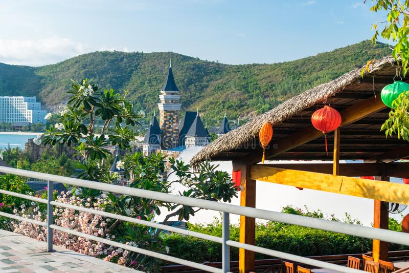Thatch roof with colorful Chinese lanterns with flowers the background of the hill stock images
