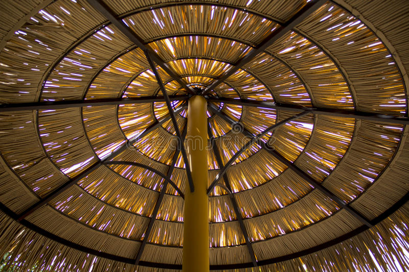 Thatch roof made from dried palm leaves took from below and inside the shed on the sunny day in tropical area. royalty free stock images