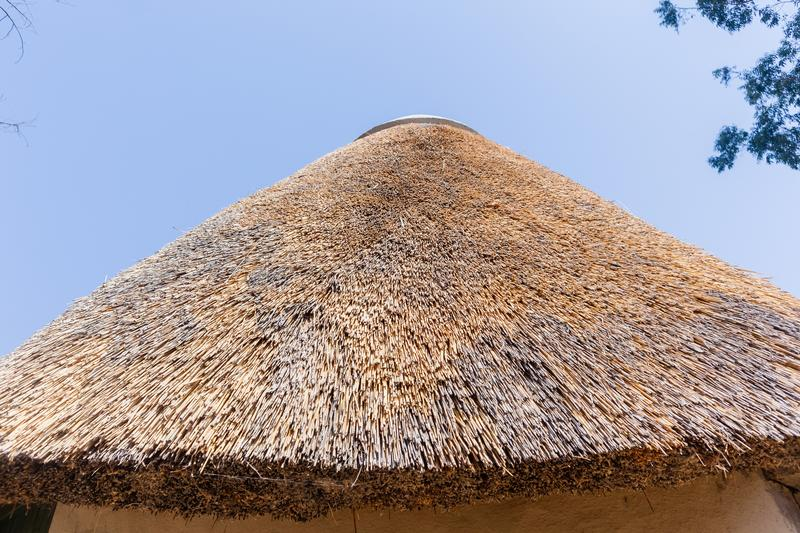 Thatch Round Camping Bungalow. African style thatch grass roofs round bungalow building holiday camps in rural mountains royalty free stock photos