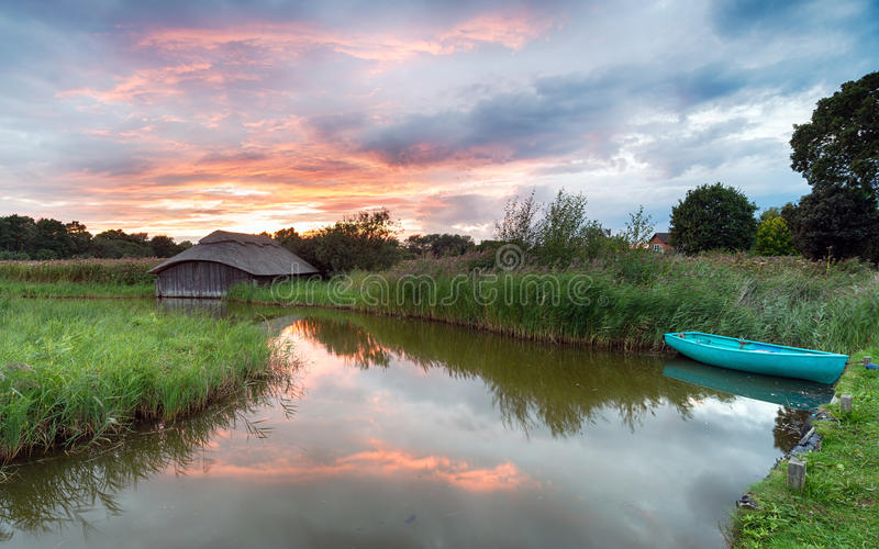 Thatched Boat House on the Norfolk Broads stock photography