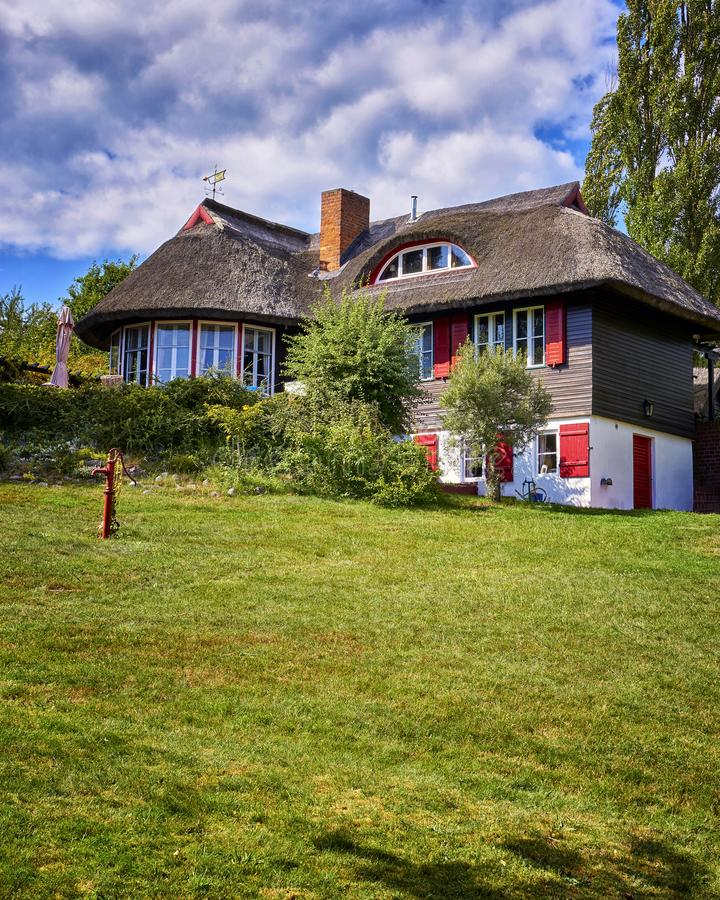 Thatched cottage on the mountain on the island Hiddensee. Germany, Mecklenburg-Vorpommern. Roof, house, grass, property, baltic, brokers, coast, landscape royalty free stock photo