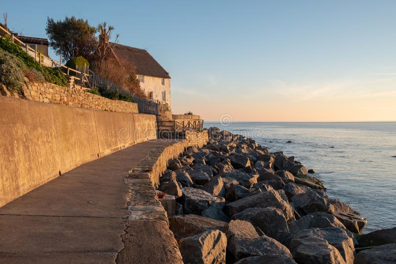 Thatched cottage and new sea defences at Runswick Bay near Whitby royalty free stock images