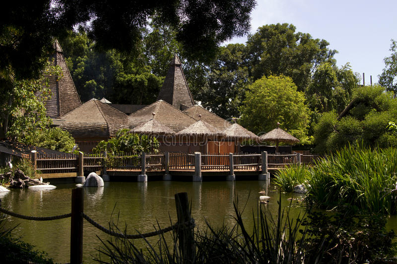 Thatched roof building in the jungle wilderness royalty free stock photo