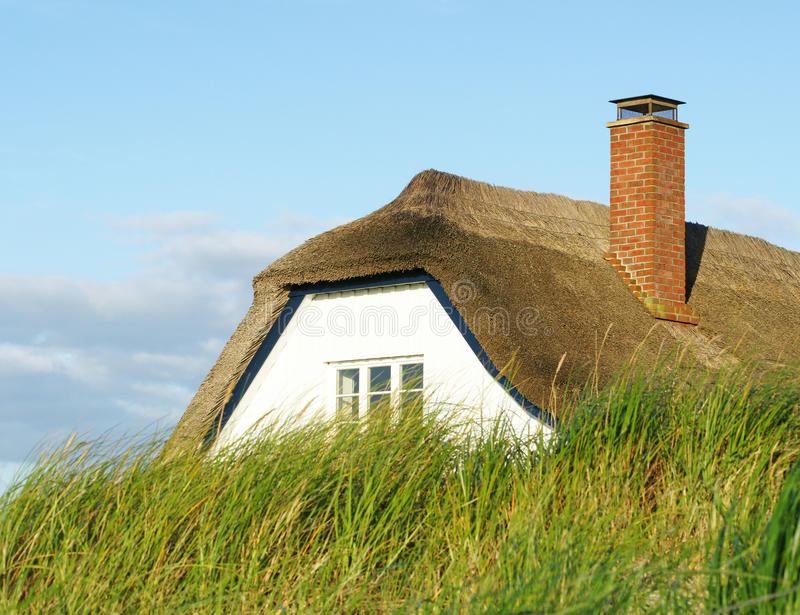 Download Thatched roof cottage stock photo. Image of home, brick - 18728378