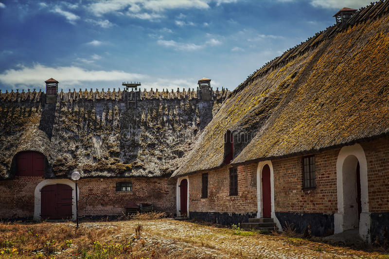 Thatched roof farmhouse stock photo