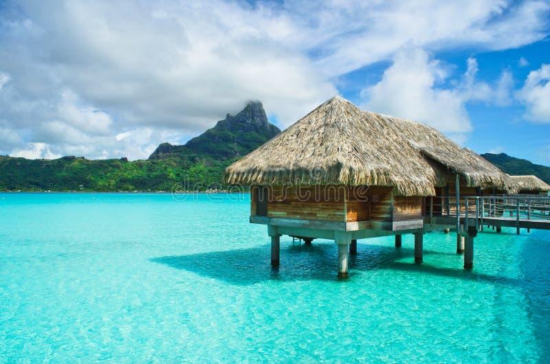Thatched roof honeymoon bungalow on Bora Bora stock photography