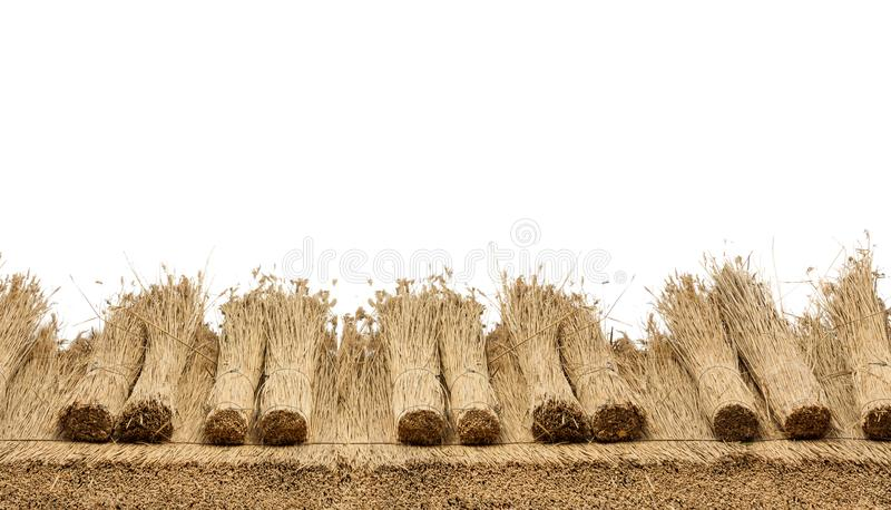 Thatched Roof on white background. Thatched roof of a house with reed , border of straw. Isolated on a white background stock images