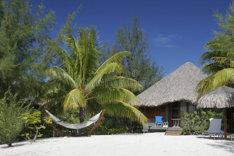 Thatched Roof Hut And Hammock Royalty Free Stock Images