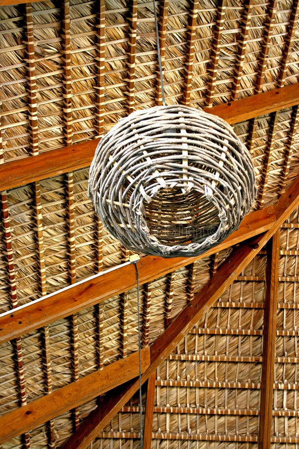 Thatched Roof with Rattan Lamp royalty free stock photo