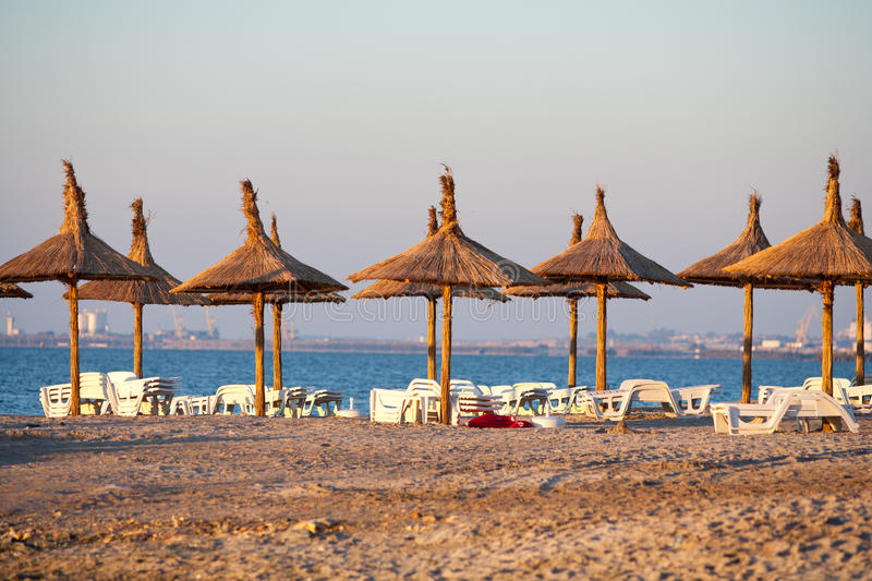 Thatched umbrellas on the beach royalty free stock images