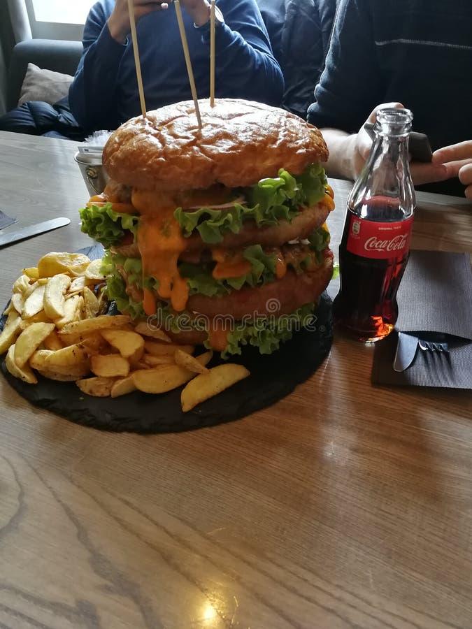 Thats a big burger stock images