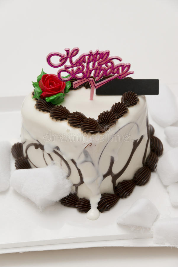 Thawing birthday ice cream cake stock image