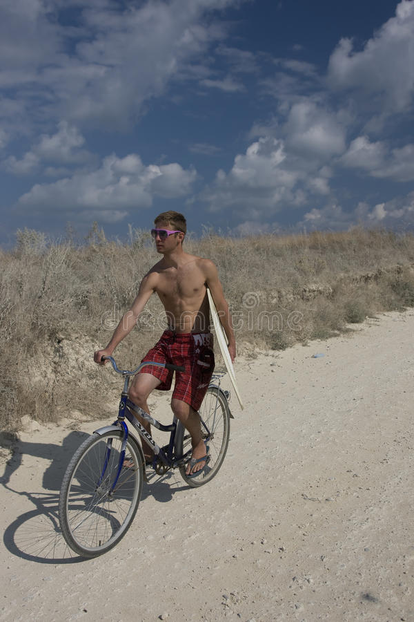 Free The Bicyclist With Surf Stock Photography - 14012292