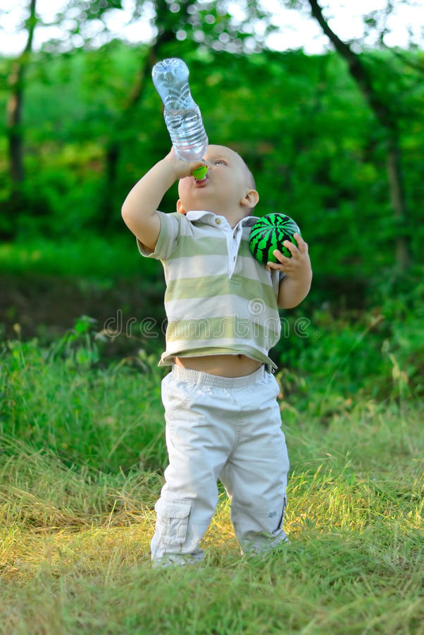 Free The Boy Drinks Water From A Bottle Stock Image - 20309451
