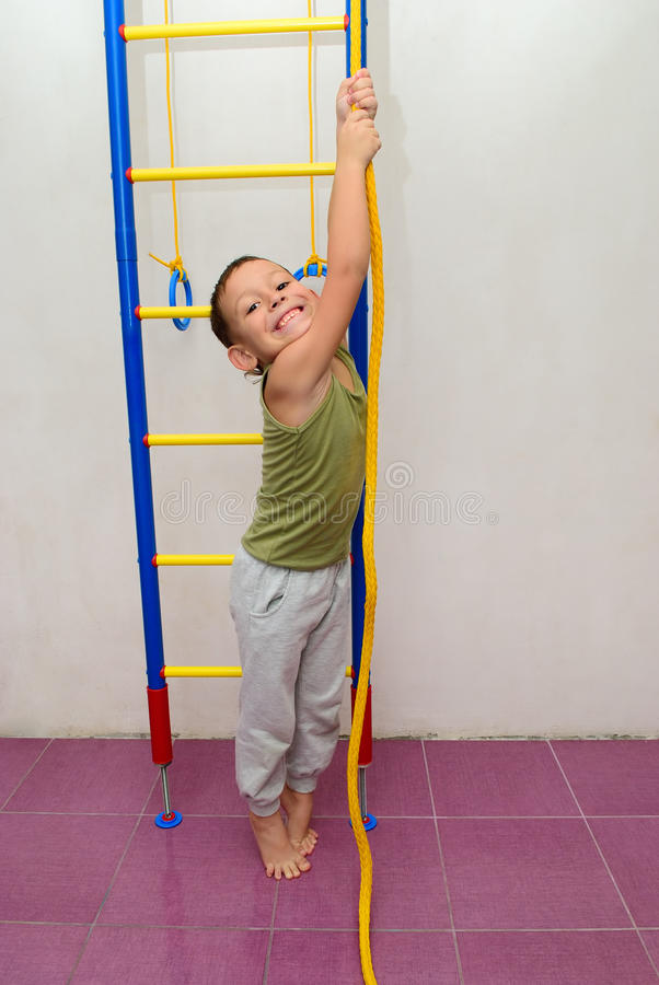 Free The Boy Is Trying To Climb A Rope Stock Image - 54788021