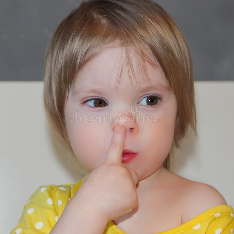 Free The Child Is Picking His Nose. A Little Girl, A Bad Habit. Picking In The Nose. Royalty Free Stock Photography - 109495927