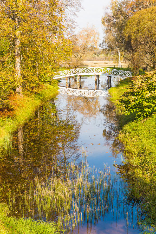 Free The Clouds And The Bridge Reflected In The Pond, The Park Of The Estate Mikhailovskoe, Pushkinskiye Mountains Royalty Free Stock Images - 47824329