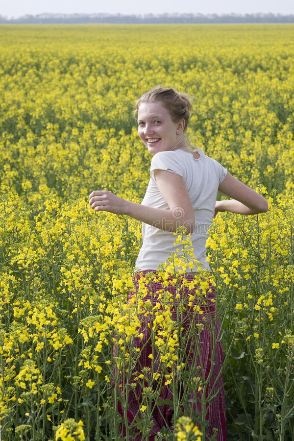 Free The Girl In The Field Of Wild Flowers Stock Photos - 13854353