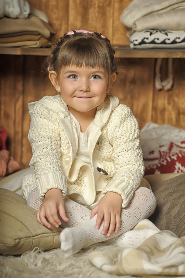 Free The Little Girl Next To The Wardrobe Royalty Free Stock Photos - 30473948