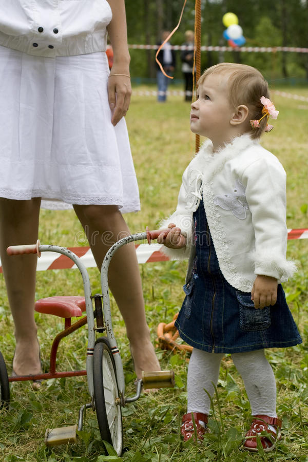 Free The Little Girl With A Tricycle Royalty Free Stock Image - 11121616
