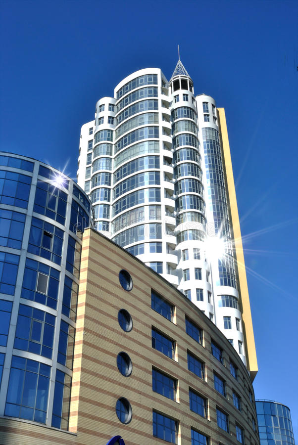 Free The Lofty White Building Is Against Dark Blue Sky Royalty Free Stock Photography - 17001007
