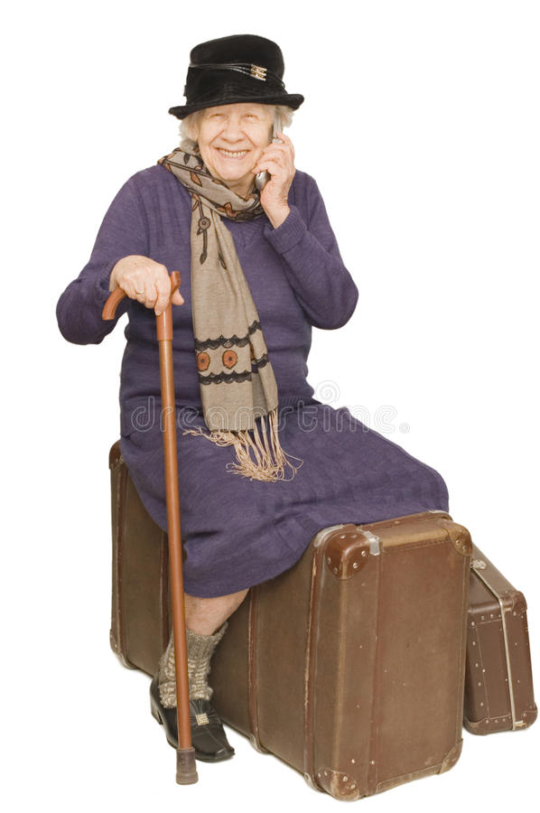 Free The Old Lady Sits On A Suitcase Royalty Free Stock Photos - 12568978