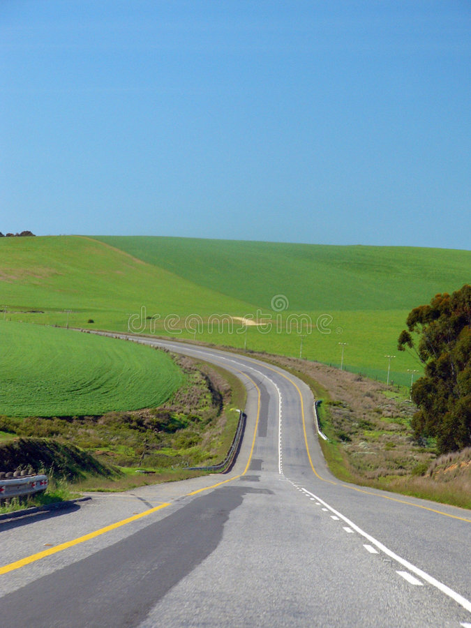 Free The Road Ahead Cuving To The Left Stock Photos - 1095883