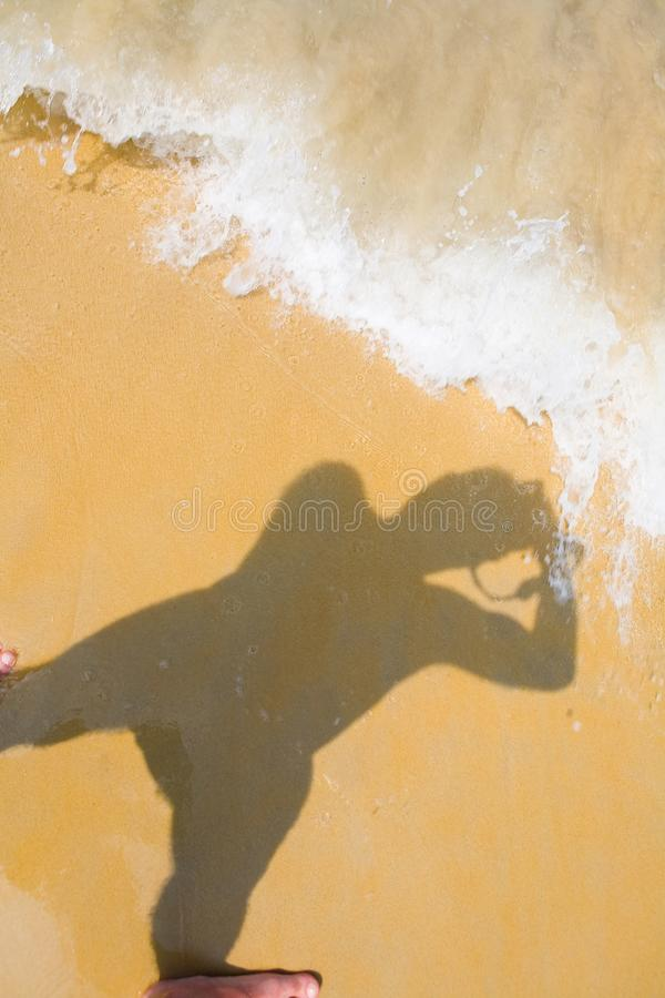Free The Shadow Of The Photographer On The Beach And The Wave. Royalty Free Stock Image - 116862966