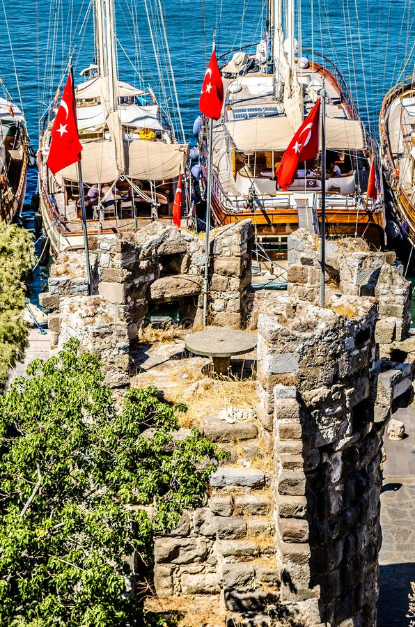 Free The Tower Of The Castle Of St. Peter In Bodrum. Among The Tower Is A Round Stone Table, And In The Background Are Visible Yachts S Royalty Free Stock Photography - 123225717