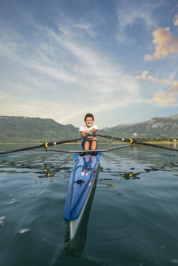 Free The Young Sportsman Is Rowing On The Racing Kayak Royalty Free Stock Image - 86124376