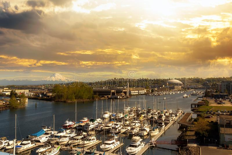 Thea Foss Waterway in Tacoma Washington state. Boat Dock along Thea Foss Waterway in Tacoma Washington with Mount Rainier during golden sunset stock photos