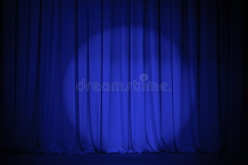 Theater blauw gordijn met lichte vlek royalty-vrije stock afbeeldingen