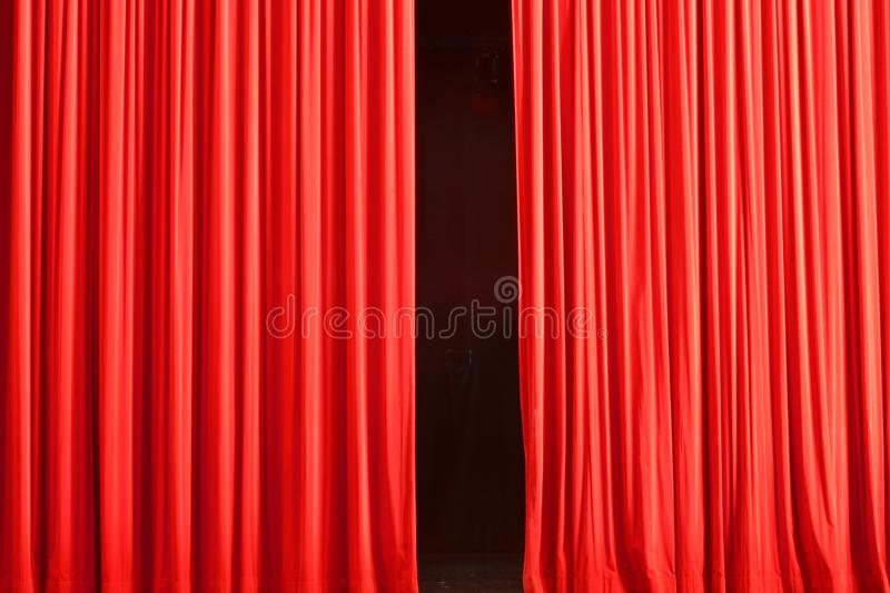 The theater curtain is about to open, the show begins. The curtain is still closed royalty free stock photography