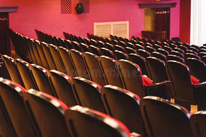 Theater hall for visitors with beautiful chairs of Burgundy-red velvet chairs before the show royalty free stock image