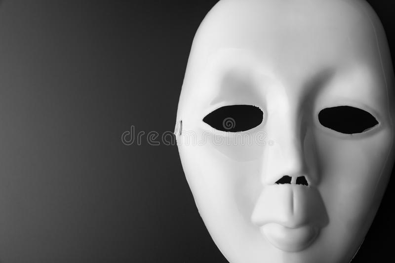 Theater mask on grey. Closeup of theater mask. In B-W royalty free stock photo