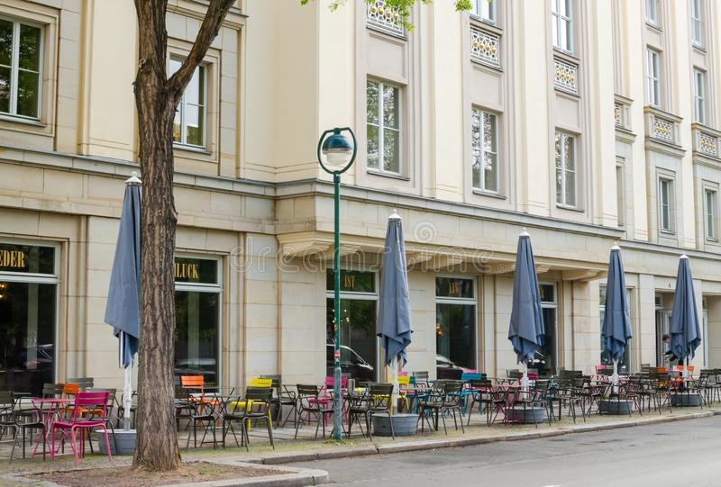 Theater Schauspiel in Leipzig, Germany. Outside view of wall and empty morning restaurant on the ground floor royalty free stock photography