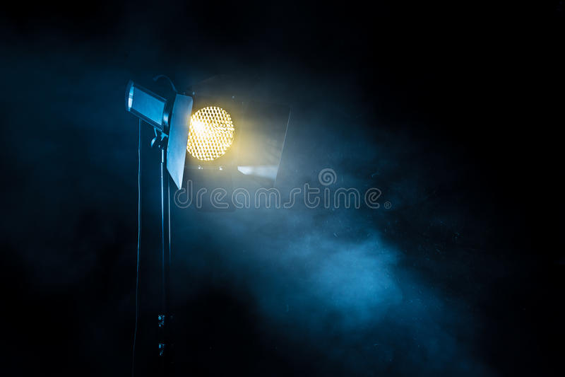 Theater spot light on black background. stock photos