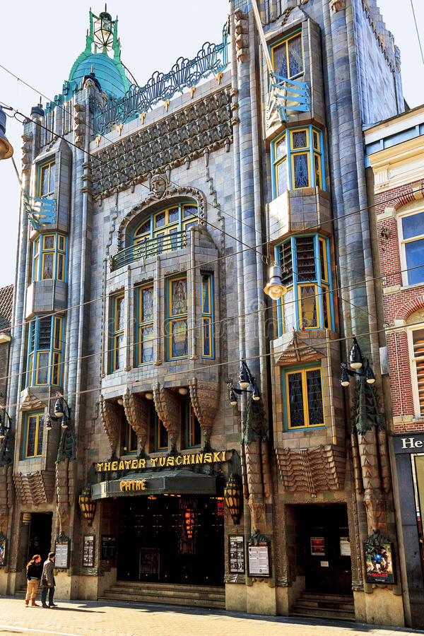 Theater Tuschinski, Amsterdam. AMSTERDAM, NETHERLANDS - MAY 5, 2013: It's an architectural landmark of the city - a building Theater Tuschinski, presenting an stock photos
