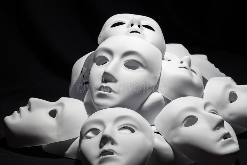 Theater white masks. Beautiful theater white masks on black background stock image
