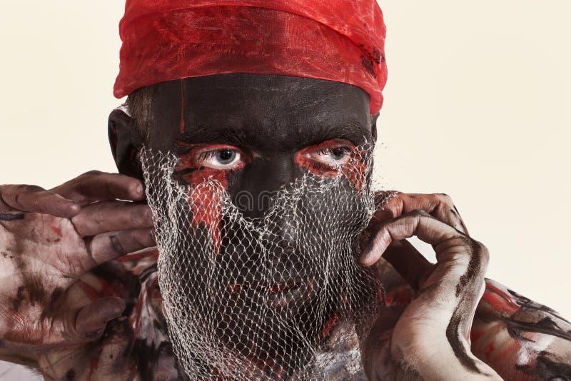 Theateracteur met zwarte samenstelling op zijn gezicht stock afbeeldingen