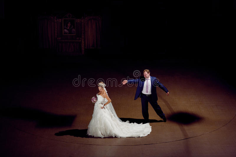 In the theatre. Bride and groom in the theatre royalty free stock photos