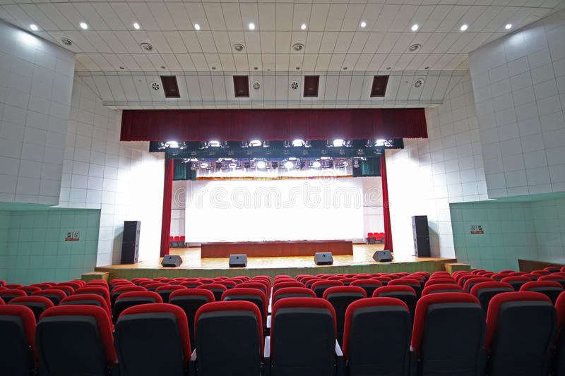 Theatre chairs and stage. Chairs and stage in a theatre in china royalty free stock image