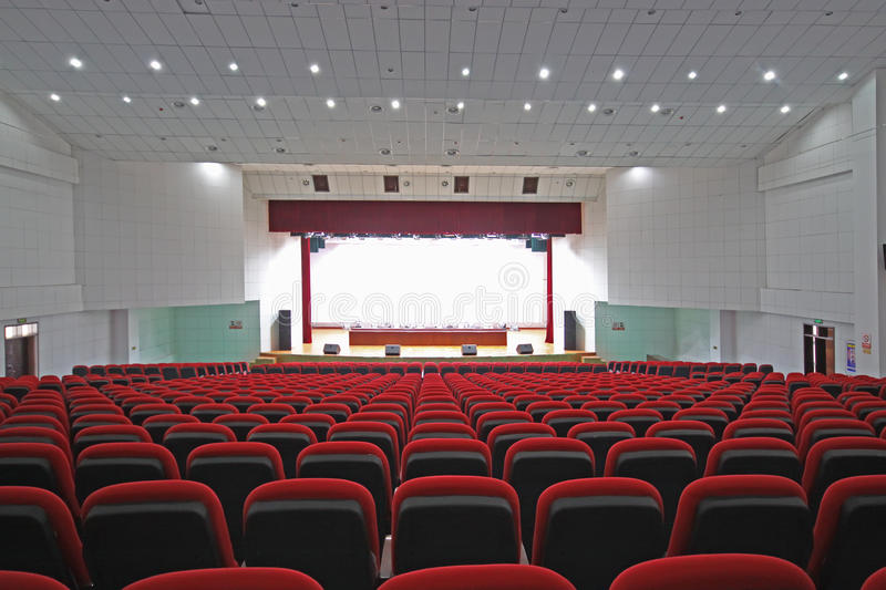 Theatre chairs and stage. Chairs and stage in a theatre in china royalty free stock images