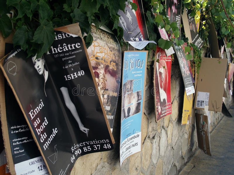 Theatre festival in Avignon, july 2005. Plenty of playbills on a wall in Avignon during famous theatre festival stock image